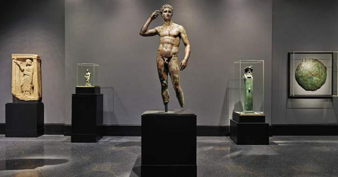 View of a newly reinstalled collection gallery at the Getty Villa. Center: Statue of a Victorious Youth, unknown, 300–100 BCE. Bronze. The J. Paul Getty Museum