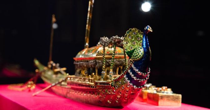 A gold enamelled and diamond-set peacock ink stand in the form of a State Barge, that is formed of 19 pieces, including a penknife, inkwells and a pair of scissors. Credit line: Royal Collection Trust /© Her Majesty Queen Elizabeth II 2018