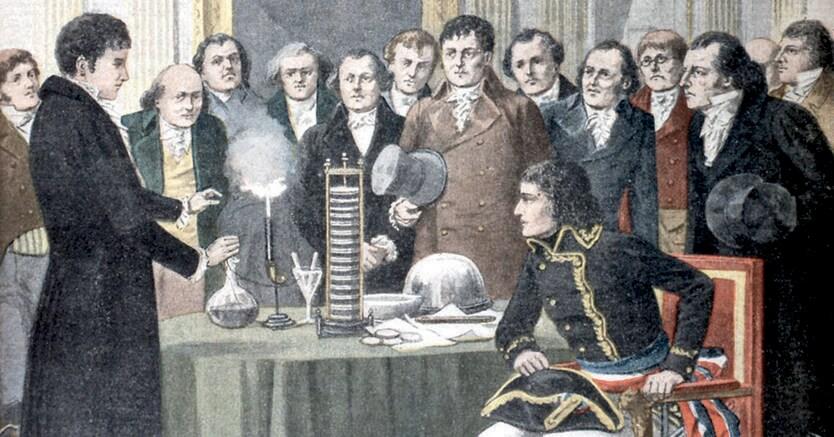 Elettricità. Alessandro Volta spiega   il funzionamento della sua invenzione, la pila, davanti a Napoleone Bonaparte e a un consesso di colleghi  nel 1801