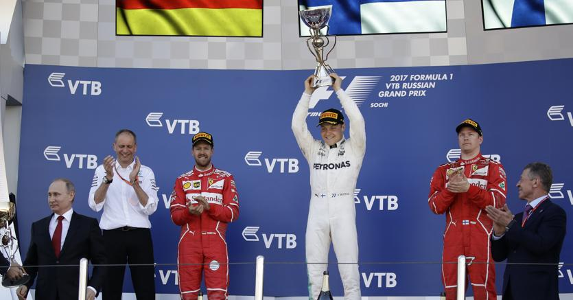 Sul podio: Vettel, Bottas, Raikkonen (Ansa/Ap)
