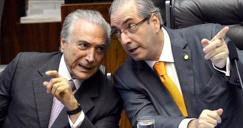 Il presidente del Brasile, Temer (a sinistra), e il presidnete della Camera, Cunha (AFP)