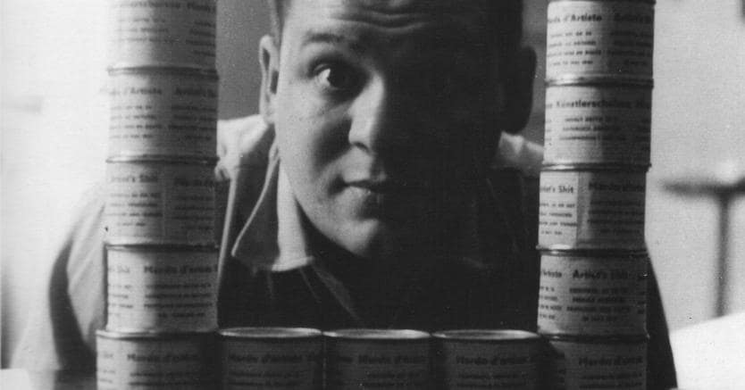 Piero Manzoni with cans of Merda d'artista (Artist's shit) in his house on Via Cernaia, Milan, Italy, 1961(© Fondazione Piero Manzoni, Milano, courtesy of the Foundation and Hauser & Wirth)