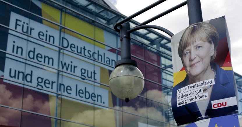 «Per una Germania in cui viviamo bene e volentieri» dice lo slogan su un poster della Cdu. (Ap)