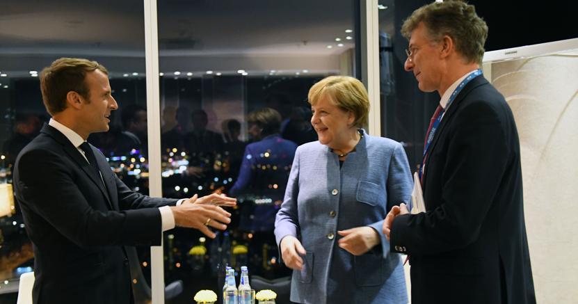 Il presidente francese Macron con la cancelliera tedesca Angela Merkel (Afp)