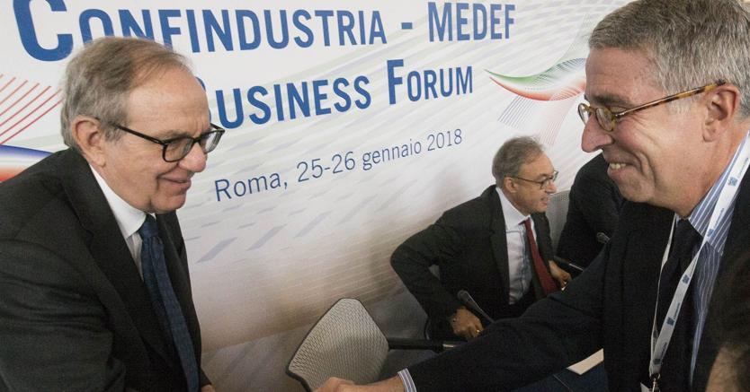 Pier Carlo Padoan e  Arnaud De Puyfontaine - Imogoeconomica