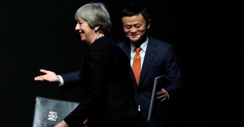 Theresa May  e Jack Ma (Reuters)