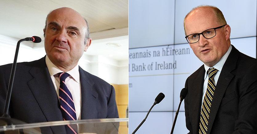 Da sinistra: Luis de Guindos (Epa) e Philip Lane (Reuters)
