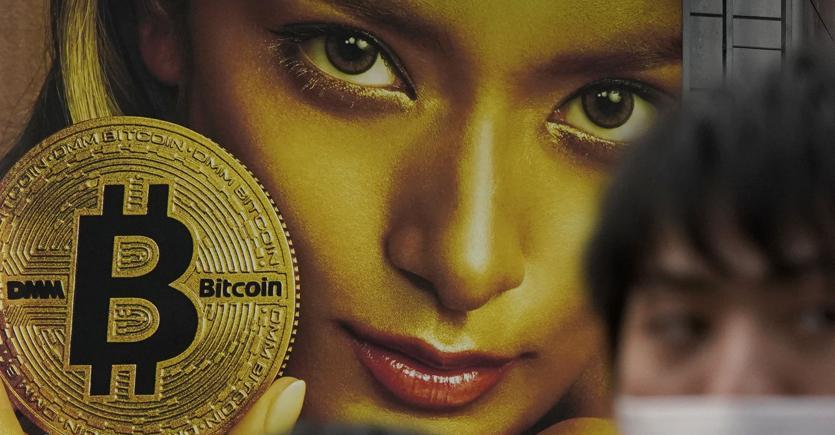Pubblicità del Bitcoin a Tokyo (Ap)
