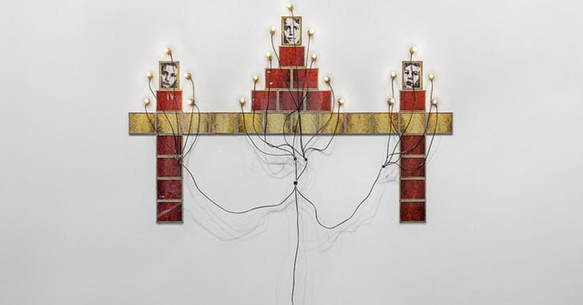 Christian Boltanski Monument, 19873 framed black and white photographs, 28 framed color photographs, lamps and electric wire© Christian Boltanski / Marian Goodman Gallery