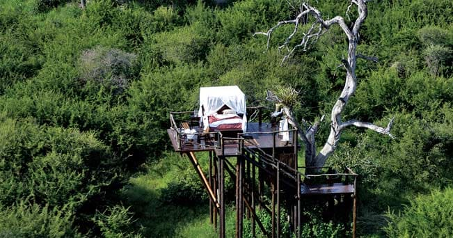 Il letto nuziale dell'Ivory Lodge nella riserva di Lion Sands