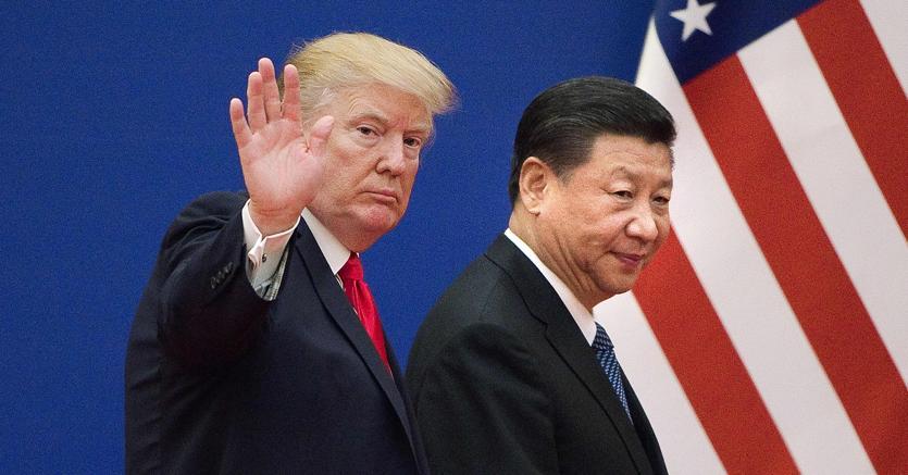 Il presidente Usa, Donald Trump con  il presidente cinese, Xi Jinping (Afp)