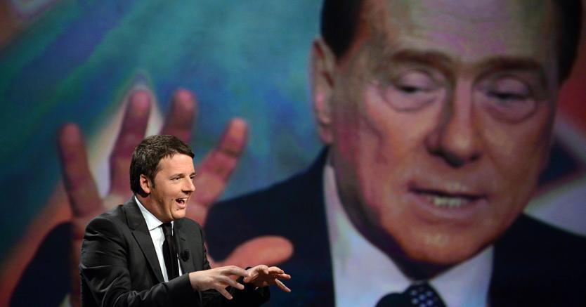 號稱新政治代表的第56任義大利總理馬泰奧‧倫齊(前),與貪腐的象徵西爾維奧‧貝魯斯柯尼(後),以迅雷不及掩耳的速度瞬間合體。