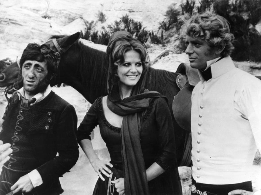 1970. Claudia Cardinale, Carlo Delle Piane e Mark Burns in 'Le avventure di  Gerard' (AGf)