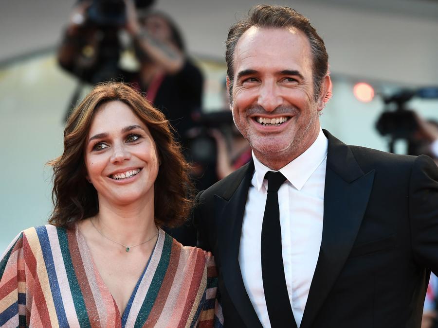 Jean Dujardin con la moglie Nathalie Pechalat. (Photo by Vincenzo PINTO / AFP)