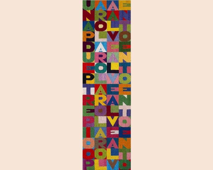 Asta 467 / lotto n. 71, Alighiero Boetti, «Una parola al vento due parole al vento tre parole al vento 100 parole al vento», 1989, ricamo, cm 90x25, valutazione 50.000-70.000 €
