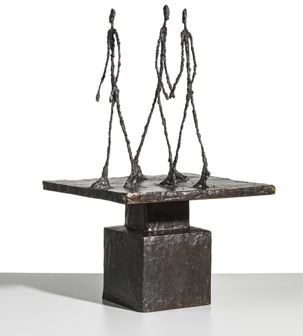 Lotto 14 - Property from a distinguished private collection. Alberto Giacometti (1901-1966). Trois hommes qui marchent (grand plateau). Price realised gbp 11.272.500. Estimate: Gbp 8.000.000 - Gbp 12.000.000. Signed and numbered 2/6 A. Giacometti (on the side of the base); stamped with the foundry mark  « Alexis Rudier . Fondeur . Paris» (on the side of the pedestal); bronze with dark brown patina. Height: 28 1/4 in. (72 cm.). Conceived in 1948 and cast in bronze in a numbered edition of six, this example cast in 1950