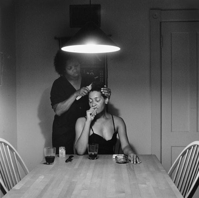 Carrie Mar Weems, Untitled (Brushing hair), 1990-1999 Gelatin silver print, 28 x 27 3/4 inches (framed), ed. 5 di 5 + 2 ap, Courtesy Jack Shainman