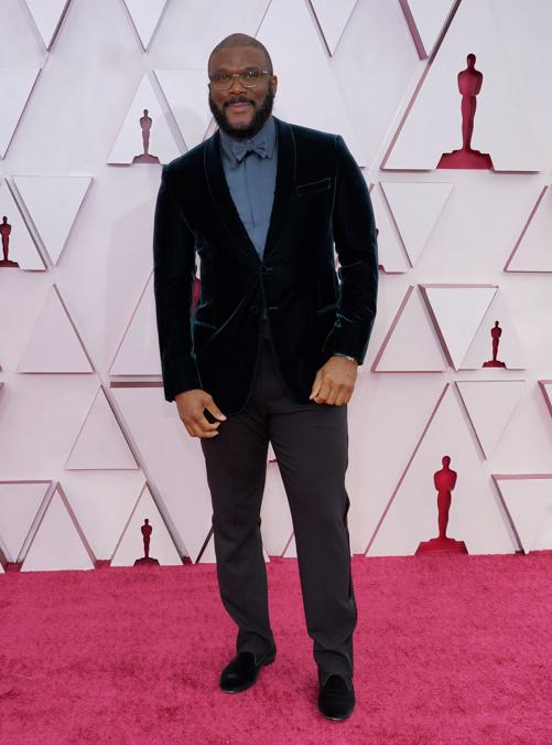 Tyler Perry in Giorgio Armani. (Photo by Chris Pizzello / POOL / AFP)