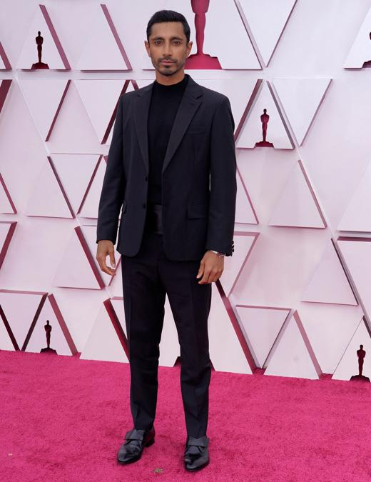 Riz Ahmed in Prada. (Photo by Chris Pizzello / POOL / AFP)