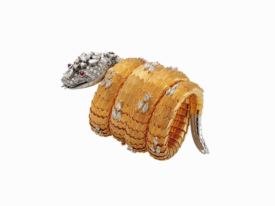 Bracciale Orologio Serpenti Bvlgari in oro e platino con rubini e diamanti 1966 Collezione Privata