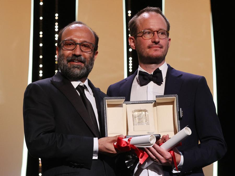 L'ambitissimo Grand Prix è stato assegnato ex aequo al potente «A Hero» dell'iraniano Asghar Farhadi e al sorprendente «Compartment No. 6» del finlandese Juho Kuosmanen. (Photo by Valery HACHE / AFP)