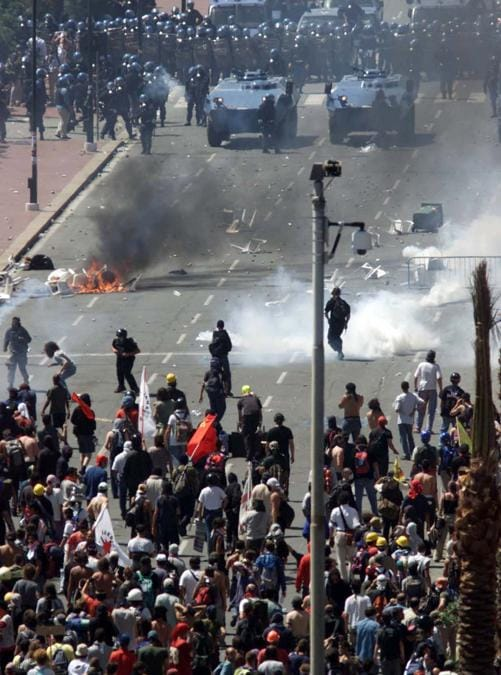 Riot police and the demonstrators clash in the center of Genoa July 21, 2001. Italian police and anti-capitalist protesters clashed on Saturday on the third day of protests in the Mediterranean city hosting the Group of Eight big power summit. (Reuters)