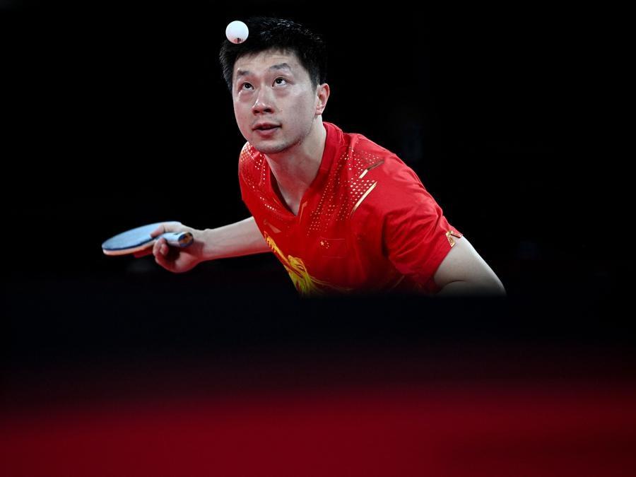 Semifinale individuale di Tennis da tavolo - Il cinese Ma Long (Photo by Anne-Christine POUJOULAT / AFP)