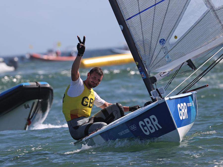 Tokyo 2020 Olympics - Sailing - Men's Finn - Medal Race - Enoshima Yacht Harbour - Tokyo, Japan - August 3, 2021. Giles Scott of Britain celebrates winning gold after competing. REUTERS/Ivan Alvarado