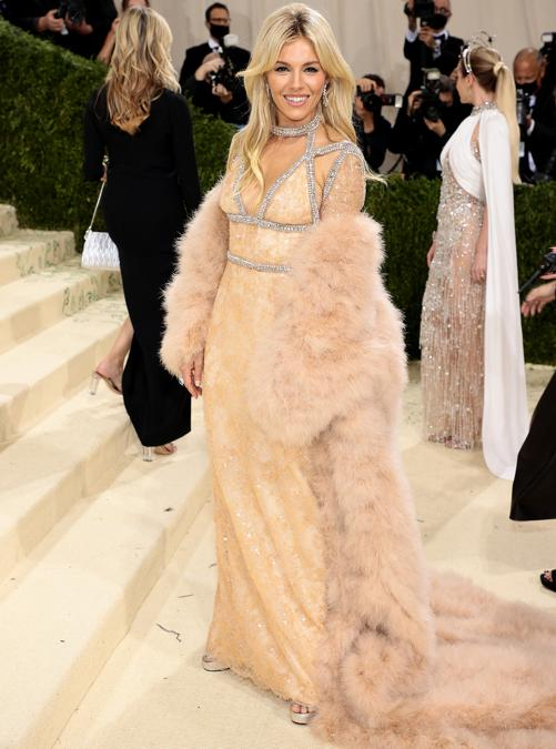 Sienna Miller   in Gucci (Photo by Dimitrios Kambouris / Getty images North America   / Getty Images via AFP)