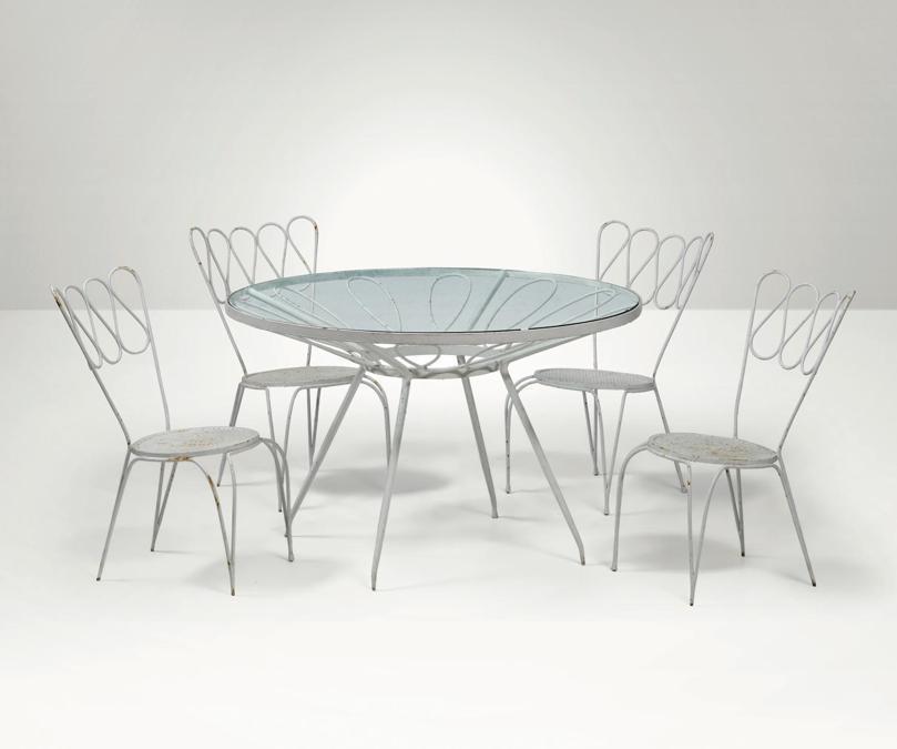Cambi un set di tavolo con quattro sedie e due capitavola di Gio Ponti, realizzato in metallo laccato e selezionato da Melchiorre Bega per una villa privata a Fregene, venduto per 9.500 euro contro una stima di 3-4mila