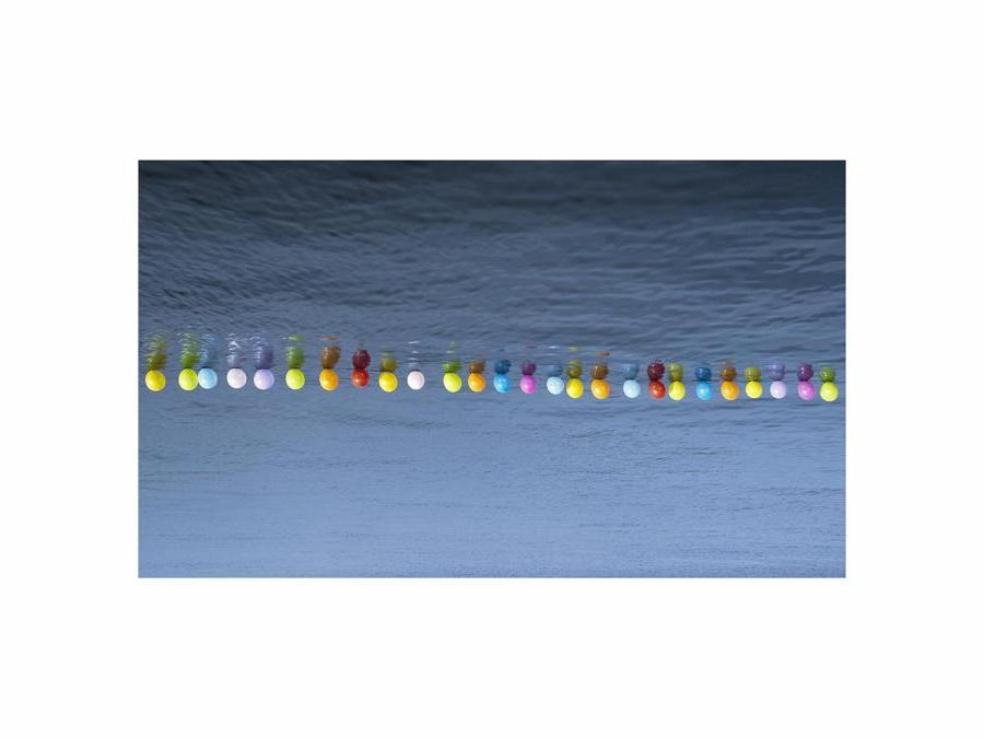 Hale Tenger. Balloon on the sea, 2011. Photographic print on Fuji Professional paper