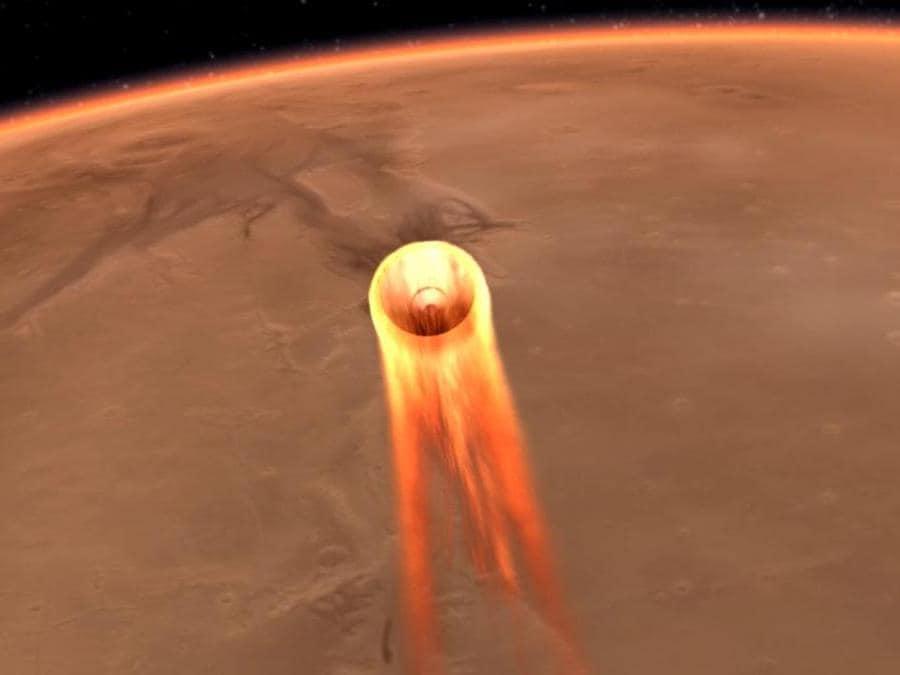 Questa immagine mostra l'ingresso, la discesa e l'atterraggio di InSight su Marte. (Photo by HO / NASA/JPL-CALTECH / AFP)