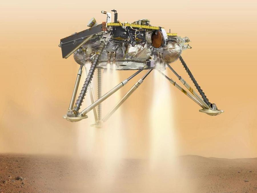 Un'illustrazione del lander InSight della NASA in procinto di atterrare sulla superficie di Marte. (NASA/JPL-Caltech via AP)