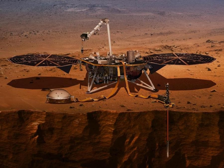 Un'illustrazione mostra il lander InSight che sta perforando la superficie di Marte. (NASA via AP)