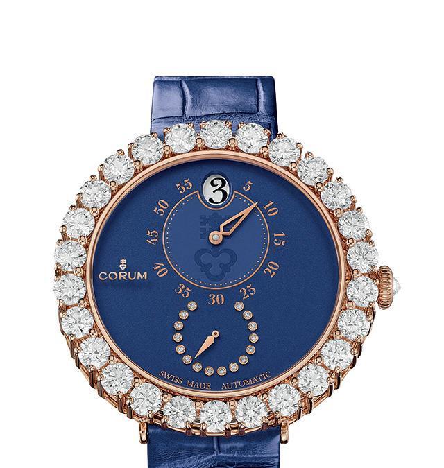 CorumL'Heritage 40 Eleganza propone due raffinate complicazioni come le ore saltanti e i piccoli secondi racchiuse in un orologio gioiello con cassa in oro rosa e lunetta impreziosita da 26 diamanti. Solo otto esemplari. Prezzo: 88 mila euro