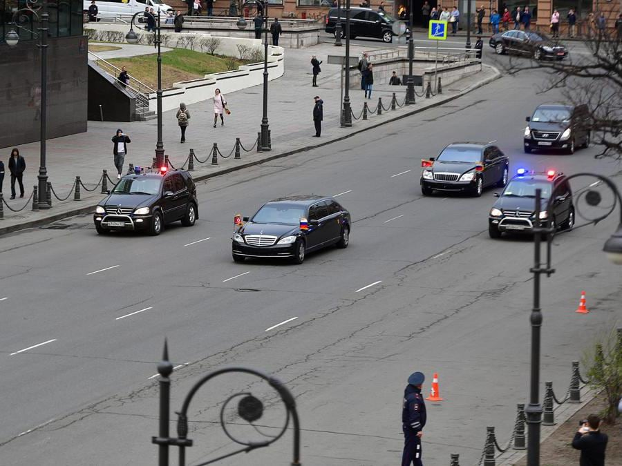 North Korean leader Kim Jong Un's motorcade drives away from the railway station in the far-eastern Russian port of Vladivostok on April 24, 2019. (Photo by STR / AFP)