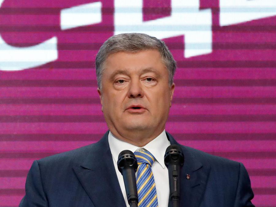Ukraine's President and presidential candidate Petro Poroshenko delivers a speech following the announcement of the first exit poll in a presidential election at his campaign headquarters in Kiev, Ukraine April 21, 2019. REUTERS/Vasily Fedosenko