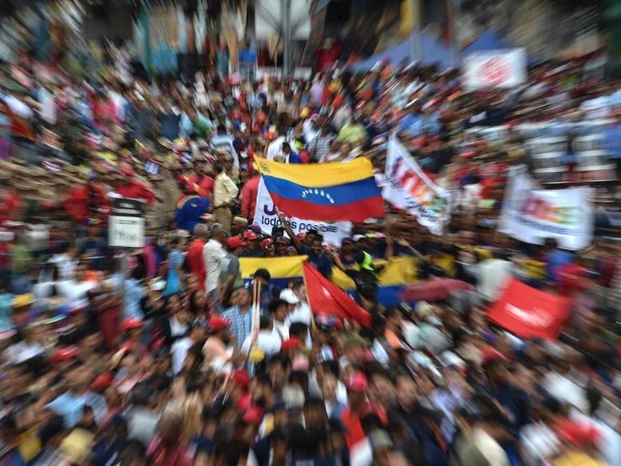 Supporters del Presidente Nicolas Maduro (Photo by Luis ROBAYO / AFP)