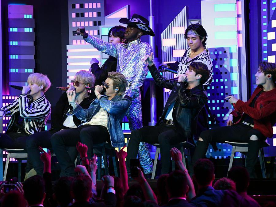 US rapper Lil Nas X (C) and South Korean boy band BTS perform onstage during the 62nd Annual Grammy Awards on January 26, 2020, in Los Angeles. (Photo by Robyn Beck / AFP)