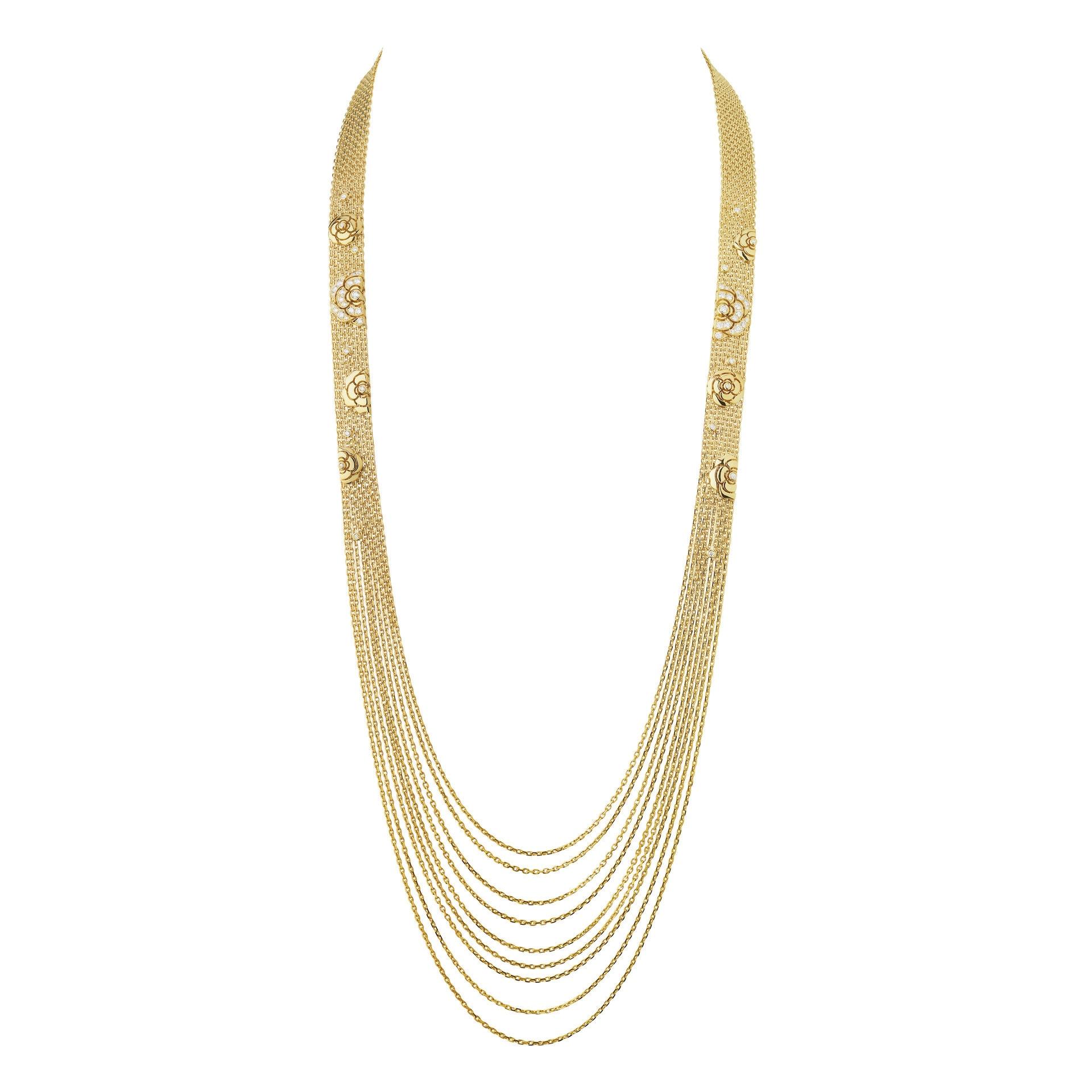 Chanel Joaillerie. Sautoir Impression de Camélia in oro giallo e diamanti con motivo piccole camelie.