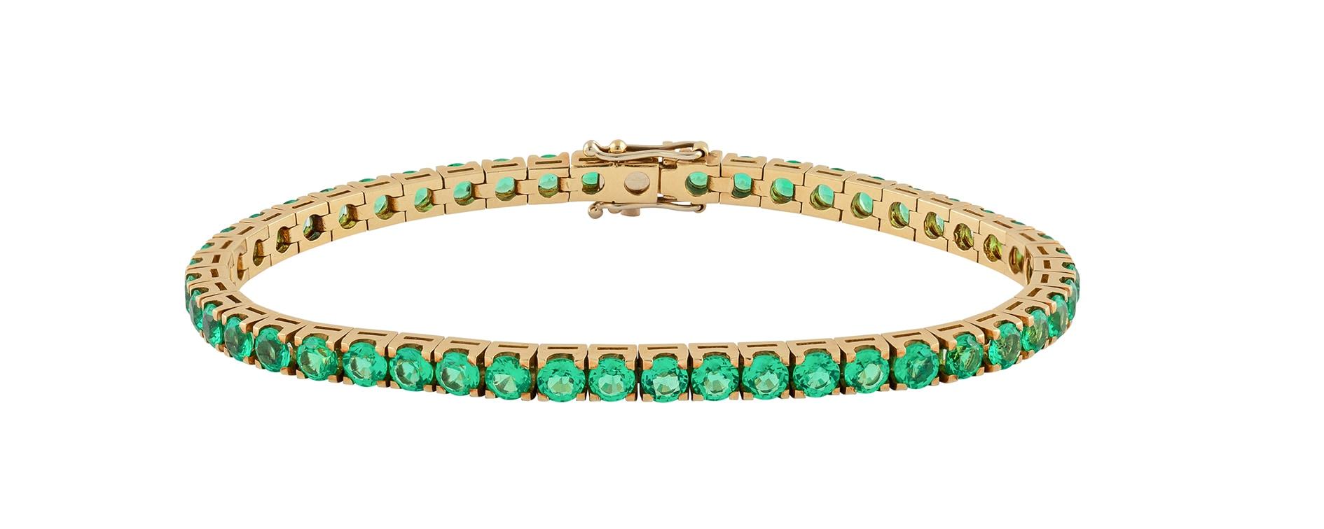 Bracciale tennis con smeraldi montati su oro giallo, PISA DIAMANTI (prezzo su richiesta).