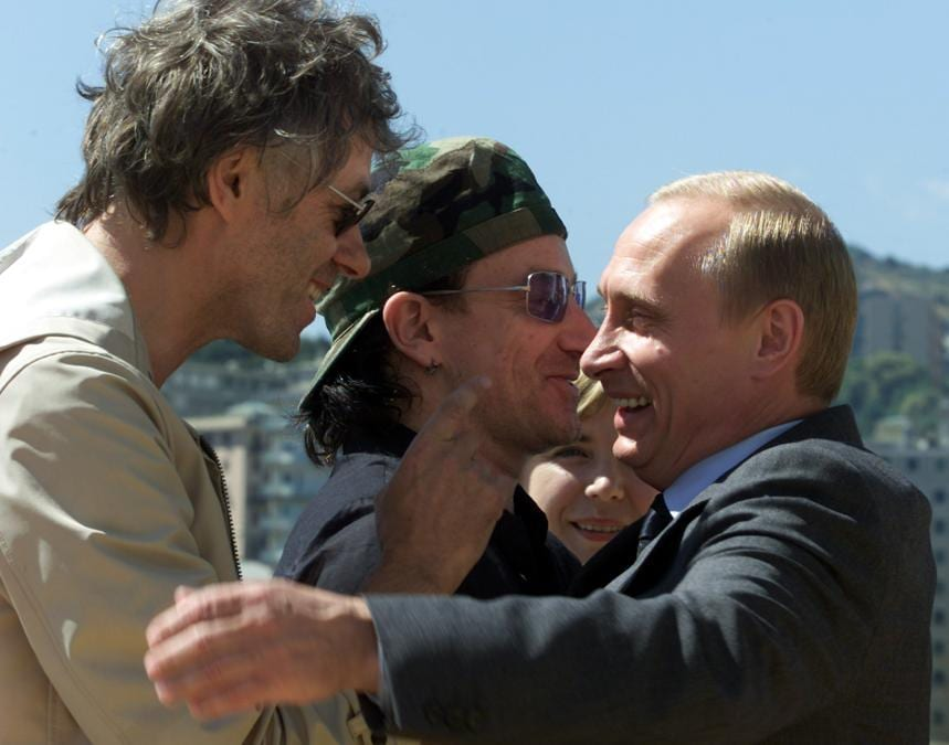 Russian Prime Minister Vladimir Putin (R) gestures as he talks with rock stars Bono (C) and Bob Geldof July 21, 2001 on the luxury cruise liner the 'European Vision' moored in Genoa's old harbour. Rock stars Bono and Bob Geldof condemned anti-capitalist violence on the streets of Genoa saying that it distracted attention away from their four year campaign to wipe out debts for the world's poorest nations. (Reuters)