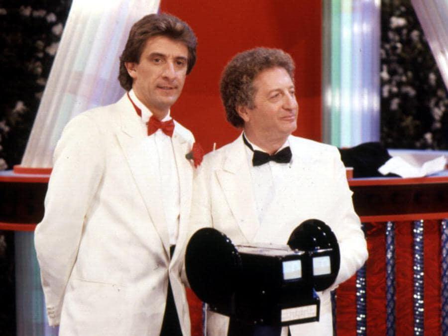 Enzo Geggio e Gianfranco D'Angelo conduttori di drive in in una foto d'archivio. (Ansa)