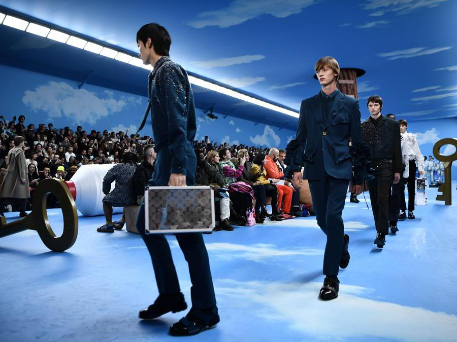 Models present creations by Louis Vuitton during the men's Fall/Winter 2020/2021 collection fashion show in Paris on January 16, 2020. (Photo by Anne-Christine POUJOULAT / AFP)