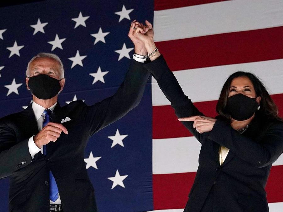 Joe Biden  e Kamala Harris . (Photo by Olivier DOULIERY / AFP)