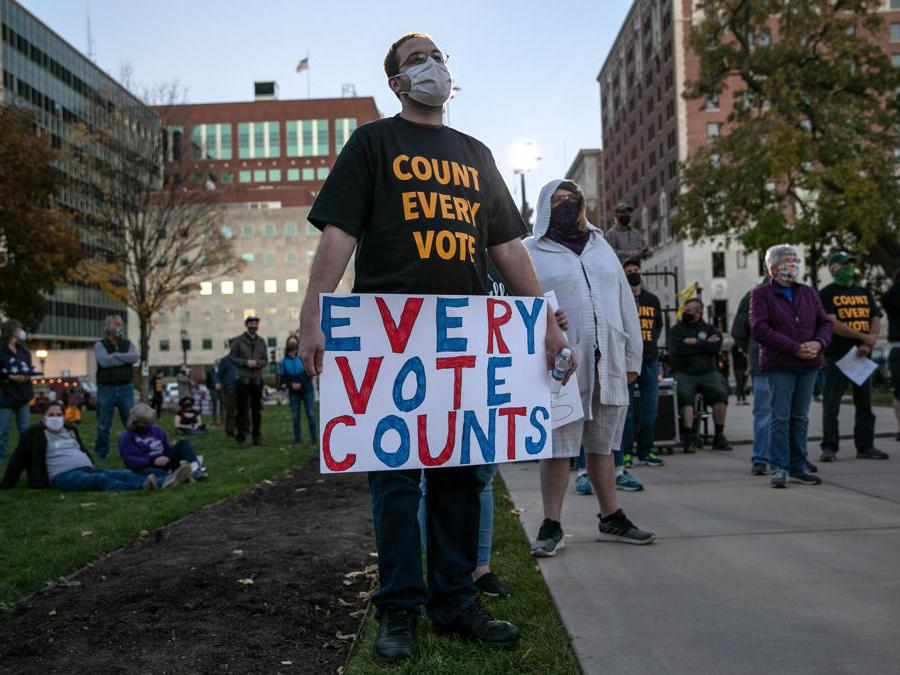 """LANSING, MICHIGAN - NOVEMBER 04: Protesters attend a """"Count On Us"""" rally at the Michigan State Capitol building on November 04, 2020 in Lansing, Michigan. People gathered to demand that all votes be counted in the 2020 election before any candidate declares victory. John Moore/Getty Images/AFP == FOR NEWSPAPERS, INTERNET, TELCOS & TELEVISION USE ONLY =="""