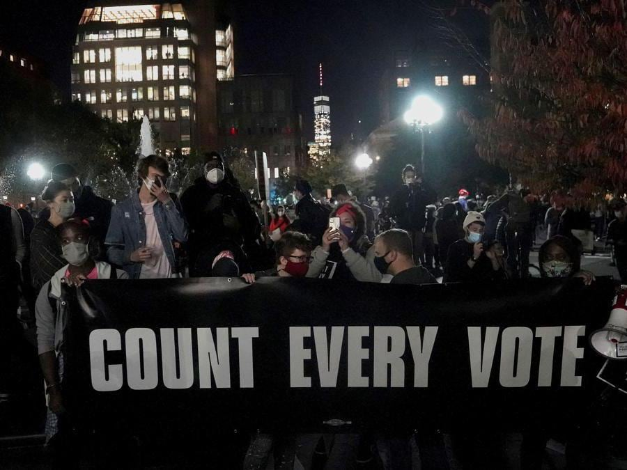 """People attend a """"Count Every Vote"""" rally at Washington Square Park the day after the U.S. election in the Manhattan borough of New York City, New York, U.S., November 4, 2020. REUTERS/Carlo Allegri"""