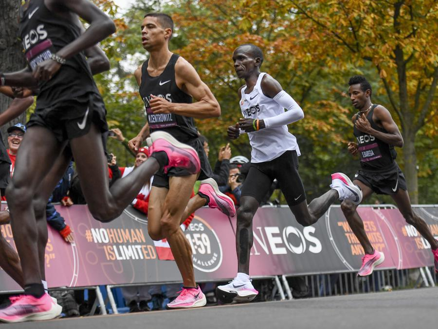 In this photo made available by The INEOS 1:59 Challenge on Saturday, Oct. 12, 2019, Eliud Kipchoge, white vest, and his team of pacemakers run along the Prater Hauptallee in Vienna, Austria. Saturday, Oct. 12, 2019, during his attempt to run a sub two-hour marathon.(Thomas Lovelock/The INEOS 1:59 Challenge via AP)