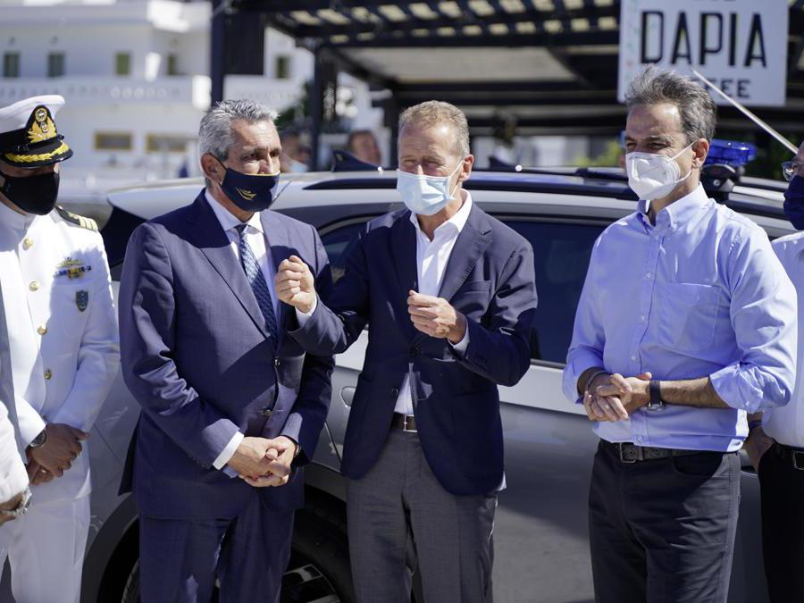 Volkswagen CEO Herbert Diess and Prime Minister Kyriakos Mitsotakis handover Greece' first electric police car in Astypalea.
