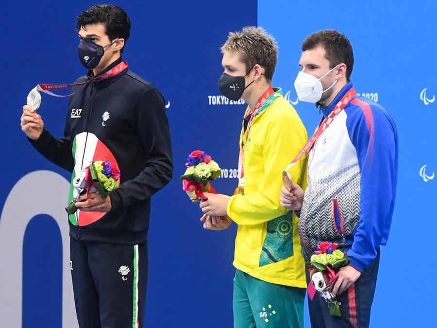 Nuoto, 100 metri farfalla S9. Da sinistra:  Simone Barlaam, medaglia d'argento, William Martin (Australia), medaglia d'oro e Alexander Skaliukh (Russia), medaglia di bronzo.  (Photo by Ilya Pitalev / Sputnik / Sputnik via AFP)